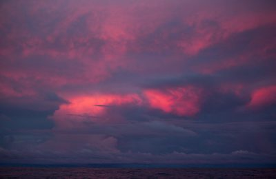 October 21, 2014. Leg 1 onboard Team Alvimedica. Day 10 brings the fleet into the ITCZ and the notoriously challenging Doldrums, an area of volatile and unpredictable weather. The clouds continue to grow in intensity long after the sun has set.
